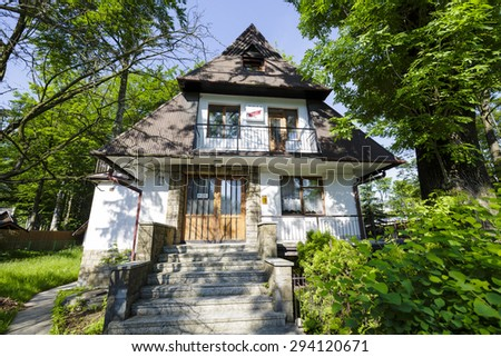 ZAKOPANE, POLAND - JUNE 12, 2015: Residential building named Villa Wieslaw, built probably in the second half of the 20th century, now offers guestrooms - stock photo