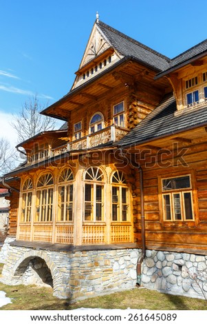ZAKOPANE, POLAND - MARCH 10, 2015: Front facade of villa Oksza, building  built in Zakopane style of wood for Vincent Korwin Kossakowski in the years 1894 & 1895 by project of Stanislaw Witkiewicz