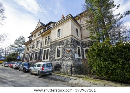 ZAKOPANE, POLAND - MARCH 06, 2016: Main Building of the Tatra Museum, built between 1913 and 1922 by joint plans of both Stanislaw Witkiewicz and Franciszek Maczynski. It is monument of architecture  - stock photo