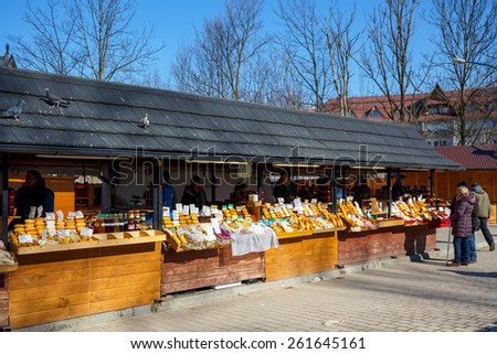 ZAKOPANE, POLAND - MARCH 10, 2015: Regional food products at the largest marketplace in the city, among other offers there is oscypek Polish regional product protected by EU law  - stock photo