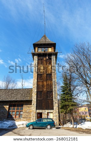 ZAKOPANE, POLAND - MARCH 10, 2015: The Observation Tower of the former Fire Department, the seat of State Fire Service in the City was located here until 2004  - stock photo