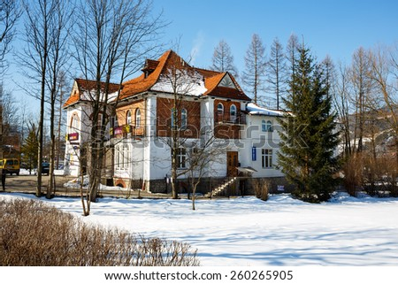ZAKOPANE, POLAND - MARCH 09, 2015: Villa Made of brick, built for Dr. Rozycki, design by E. Wesolowski in 1913, listed in the municipal register of architectural heritage, nowadays Alior Bank branch  - stock photo
