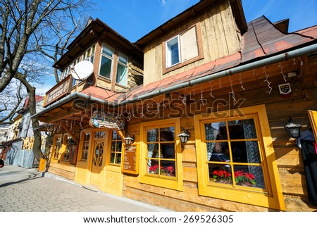 ZAKOPANE, POLAND - MARCH 10, 2015: Villa Marysin, built of wood in 1897, on the ground floor runs the newly opened Bar, renovated in 2014 - stock photo
