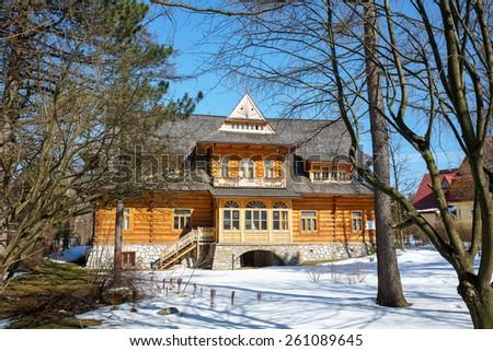 ZAKOPANE, POLAND - MARCH 09, 2015: Villa named Oksza built in Zakopane style of wood for Vincent Korwin Kossakowski in the years 1894 & 1895 by project of Stanislaw Witkiewicz  - stock photo