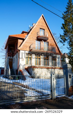 ZAKOPANE, POLAND - MARCH 09, 2015: Villa named Strzelista built in 1929, with historic features listed in the register of architectural heritage   - stock photo