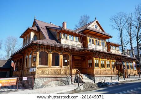 ZAKOPANE, POLAND - MARCH 09, 2015: Villa Slimak wooden house, built in the Zakopane style in 1902 by Jedrzej Slimak, according to the guidelines of Stanislaw Witkiewicz  - stock photo