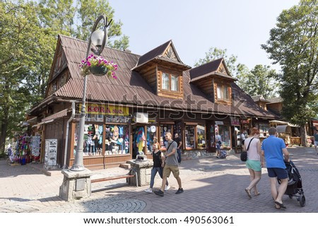 ZAKOPANE, POLAND - SEPTEMBER 12, 2016: Formerly residential building, nowadays commercial building that is dated from approx in 1900, located by the Krupowki, the main pedestrian street in the city