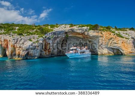 ZAKYNTHOS ISLAND, GREECE - JUNE 2015: Tourist boat in Blue Caves - stock photo