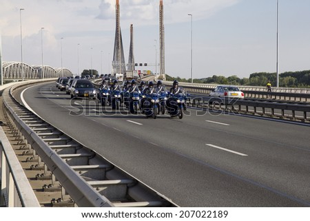 ZALTBOMMEL, THE NETHERLANDS - 24 JULY 2014. A procession of hearses crosses the Martinus Nijhoff bridge on the A2 highway, carrying victims of the crash of Malaysian Airlines flight 17 in Ukraine.  - stock photo