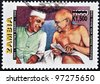 ZAMBIA - CIRCA 1998: A stamp printed in Zambia shows Mahatma Gandhi with Nehru, circa 1998 - stock photo