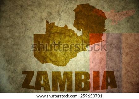 zambia map on a vintage zambian flag background - stock photo