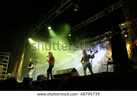 "ZAMORA, SPAIN - AUGUST 17: Popular Spanish band ""Medina Azahara"" performs onstage in Pobladura de Aliste on August 17, 2005 in Zamora, Spain - stock photo"