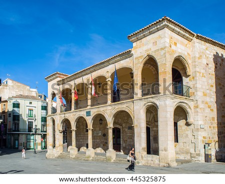 Zamora, Spain - June 19, 2016: People walking in front of principal facade of old town hall in mayor square of Zamora, Castilla y Leon. Spain.