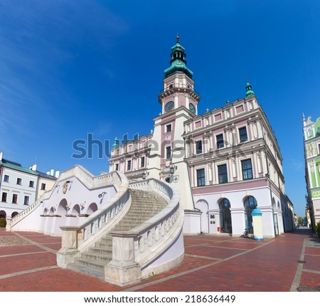 Zamosc, Poland. Historic buildings with the town hall in the Great Market. Wide angle view. - stock photo