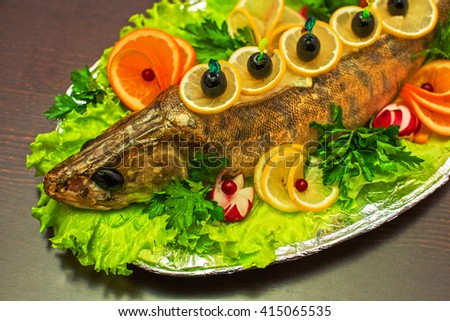 zander fish baked with greens fruits and vegetables - stock photo