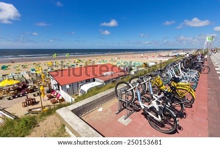 ZANDVOORT, NETHERLANDS - OCT 10: View on the beach of Zandvoort aan Zee on Oct 10, 2014 in Zandvoort, Netherlands. Zandvoort a major beach resort, it has a long sandy beach bordered by coastal dunes. - stock photo
