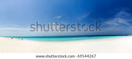 Zanzibar beach, white sand, blue sky, clear water - stock photo