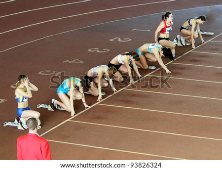 ZAPORIZHIA, UKRAINE - JAN 27: Olesya Povh (in red singlet) - world leader in 60 m. dash competes with result 7.19 in the Ukrainian Cup in Athletics on January 27, 2012 in Zaporizhia, Ukraine.