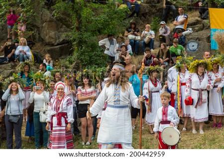 ZAPORIZHIA, UKRAINE-JUNE 21: Celebrating Kupala Night 21, 2014 in Zaporizhia, Ukraine. Celebration of pagan Slavic holiday Kupala Night - stock photo