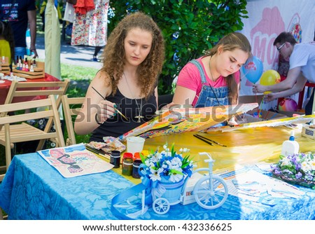 Zaporizhia/Ukraine- June 5, 2016: girls on painting workshop during charity family festival organized in regions with most quantity refugees from Donetsk, occasioned to International Children`s Day
