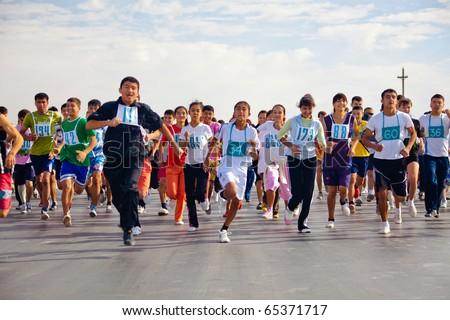 ZARAFSHAN, UZBEKISTAN - OCTOBER 16: Traditional athletics memory Vasiliy Poverennov.  October 16, 2010 in Zarafshan, Uzbekistan. - stock photo
