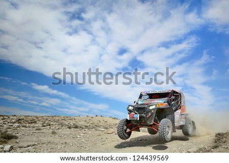 ZARAGOZA, SPAIN - JUL 21 : Isidre Esteve and Jose Maria Villalobos, in a Polaris RZR XP 900, race in Baja Spain, on Jul 21, 2012 in Zaragoza, Spain - stock photo