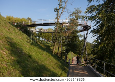 Zarasai, Lithuania - July 25, 2015: Tourists are visiting Zarasas lake observation bridge and watershore of Zarasas lake on July 25, 2015 in Zarasai, Lithuania