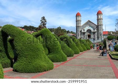 ZARCERO, COSTA RICA - JANUARY 18: Francisco Alvardo Park with its famous topiary and the Church of San Rafael in Zarcero, Costa Rica on January 18, 2015. - stock photo