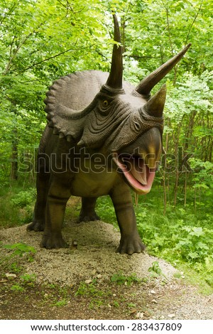 Zator, Poland: 20 July 2012. Dinosaurs model in forest, Zator in Poland - stock photo
