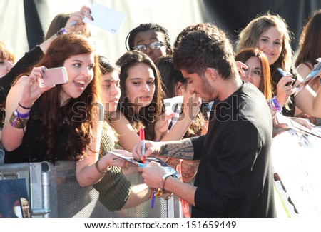 Zayn Malik from One Direction arriving at the UK Premiere of 'One Direction, This Is Us' at the Empire Leicester Square, London. 20/08/2013 - stock photo