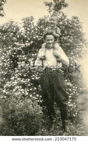 ZBICZNO, POLAND, CIRCA JUNE 1946 - Vintage photo of father with little son - stock photo
