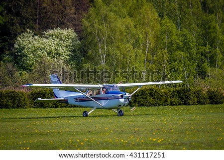 Zbraslavice, Czech Republic - May 8, 2016 - Cessna, four seat single engine civil utility aircraft, preparing before start on the flowering meadow. Central Europe.