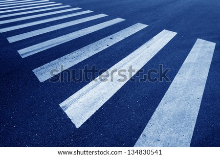 zebra crossing on the road, closeup of photo - stock photo