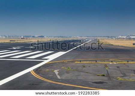 Zebra crossing on the runway of an airport, Benito Juarez International Airport, Mexico City, Mexico - stock photo