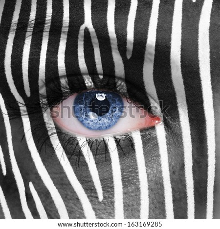 Zebra pattern on human face  - stock photo
