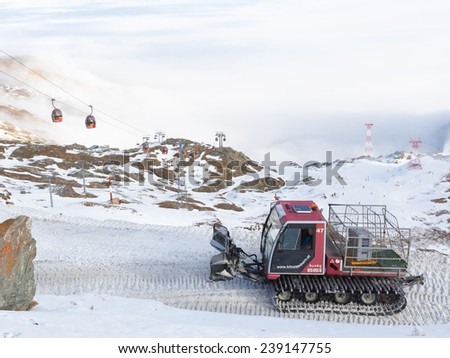 Zell am Cee - Kaprun - December 6, 2014: snow machine rides on the dirt road to the ski resort in the Alps in winter on the glacier Kitssteynhorn December 6, 2014, Zell am Cee - Kaprun, Austria