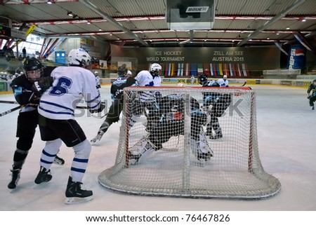ZELL AM SEE, AUSTRIA - APRIL 30: Hockey world tournament. Scoring chance for Kiev at Bantam major game Black wings Linz vs. Sokol-96 Kiev. Result 2:1 at the hockey rink Zell am See at April 30, 2011. - stock photo