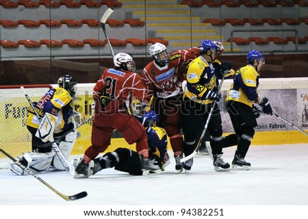 ZELL AM SEE; AUSTRIA - AUG 30: Austrian National League. Fight in front of the net of EK Zell am See. Game EK Zell am See vs KAC II (Result 2-3) on August 30, 2011 in Zell am See. - stock photo