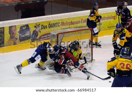 ZELL AM SEE, AUSTRIA - DECEMBER 7: Austrian National League. Action in front of Zell am See Goalie. EK Zell am See vs. Red Bulls Salzburg (Result 4-6) on December 7, 2010 at hockey rink Zell am See, Austria - stock photo