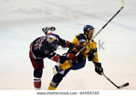 ZELL AM SEE, AUSTRIA - DECEMBER 7: Austrian National League. Hard hit by Jakub Nakovsky. Game EK Zell am See vs. Red Bulls Salzburg (Result 4-6) on December 7, 2010, at hockey rink of Zell am See, Austria - stock photo