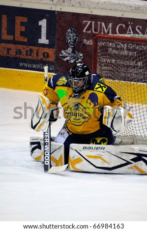 ZELL AM SEE, AUSTRIA - DECEMBER 7: Austrian National League. Save by Goalie Bartholomaeus. Game EK Zell am See vs. Red Bulls Salzburg (Result 4-6) on December 7, 2010, at hockey rink of Zell am See, Austria - stock photo