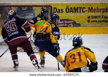 ZELL AM SEE, AUSTRIA - DECEMBER 7: Austrian National League. Scoring chance for Red bulls Feichtner. EK Zell am See vs. Red Bulls Salzburg (Result 4-6) on December 7, 2010 at hockey rink Zell am See, Austria - stock photo