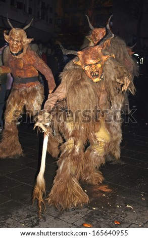 ZELL AM SEE, AUSTRIA - DECEMBER 5: Unidentified men wears Krampus (devil) mask at traditional procession on December 5, 2006 in Zell am See. - stock photo