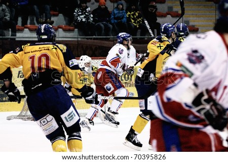ZELL AM SEE, AUSTRIA - FEB 1: Austrian National League. Action in Zell am See defensive zone. Game EK Zell am See vs. ATSE Graz (Result 4-1) on February 1, 2011, at hockey rink of Zell am See - stock photo