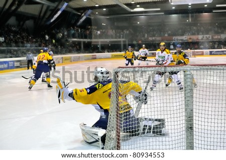 ZELL AM SEE, AUSTRIA - FEB 22: Austrian National League. Goalie Bartholomaus saves the puck. Game EK Zell am See vs. VEU Feldkirch (Result 3-1) on February 22, 2011 at hockey rink of Zell am See - stock photo