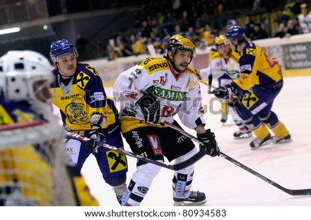 ZELL AM SEE, AUSTRIA - FEB 22: Austrian National League. Scoring chance for Feldkirch. Game EK Zell am See vs. VEU Feldkirch (Result 3-1) on February 22, 2011 at hockey rink of Zell am See - stock photo