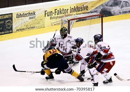 ZELL AM SEE, AUSTRIA - FEB 1: Austrian National League. Stefan Uhl misses with a shot. Game EK Zell am See vs. ATSE Graz (Result 4-1) on February 1, 2011, at hockey rink of Zell am See - stock photo