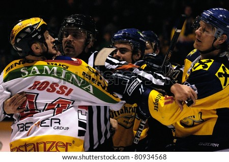 ZELL AM SEE, AUSTRIA - FEB 22: Austrian National League. Suorsa and Rossi in a brawl after the game. EK Zell am See vs. VEU Feldkirch (Result 3-1) on February 22, 2011 at hockey rink of Zell am See - stock photo