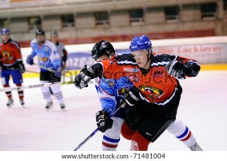 ZELL AM SEE, AUSTRIA - FEB 13: Salzburg hockey League. Stefan Leitgob tripped by Morzg player. Game SV Schuttdorf vs HCS Morzg  (Result 9-3) on February 13, 2011 at the hockey rink of Zell am See - stock photo