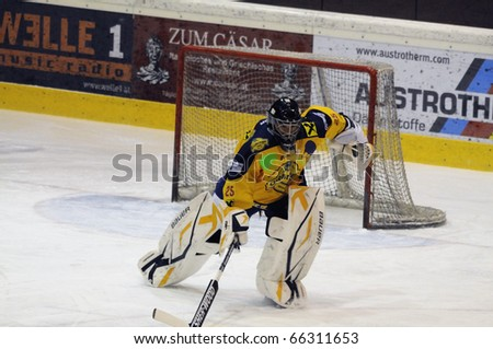 ZELL AM SEE, AUSTRIA - NOVEMBER 30: Austrian National League. Goalie Bartholomaeus charging to bench. Game EK Zell am See vs. ATSE Graz (Result 0-4) on November 30, 2010 at hockey rink Zell am See - stock photo